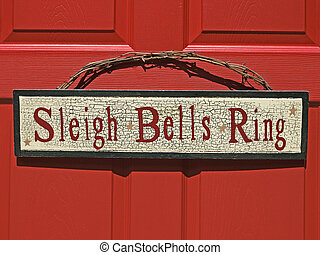 Christmas holiday sign - sleigh bells ring written on sign...