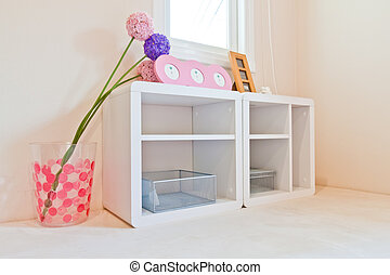 White wooden shelves on the corner of room with decoration