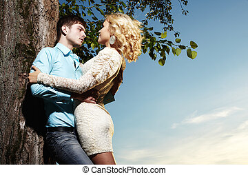 Portrait of love couple embracing outdoor in park
