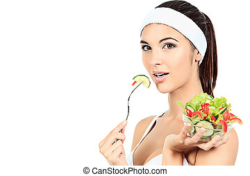 salad - Portrait of a beautiful young woman eating vegetable...