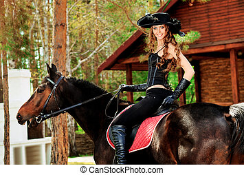 grand - Beautiful young woman in medieval costume is riding...