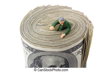 Drowning in Debt - Miniature man drowning in a roll of...