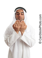 Arab man with open palms praying - An arab middle eastern...