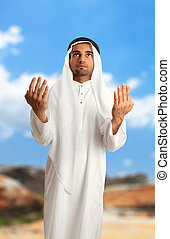 Middle eastern arab man with arms outstretched - A mixed...