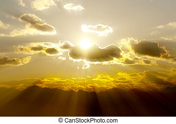 sun rays sky and clouds in mountain landscape