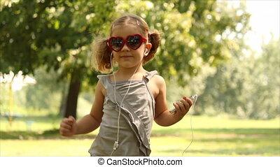 little girl listening music and dan
