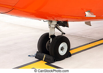 Undercarriage - A picture of an orange undercarriage of a...