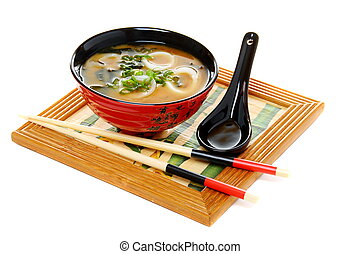 Miso soup with green onion on white background. - Miso soup...