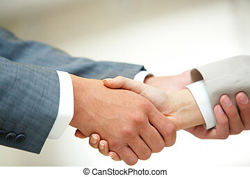 Helping hand - Photo of handshake of business partners after...