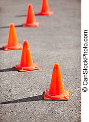 Traffic cones - Erected orange cones mark driving course,...