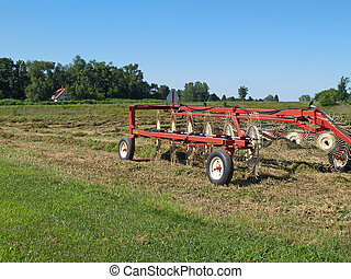 Hay Rake Sitting in a Field of Just - Hay rake sitting in a...