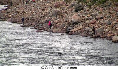 fishermen fishing in river - fishermen fishing in mountain...