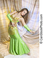 pretty sexual blond doing belly dance - caucasian...