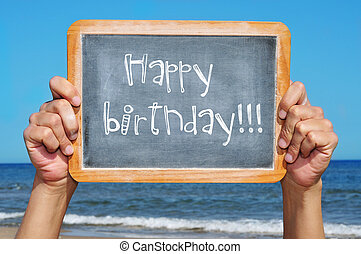 happy birthday - someone holding a blackboard with the...