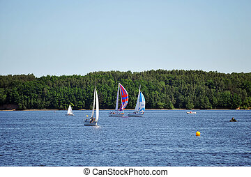 Sailboats on lake - Sailboats on the blue water. summer day...