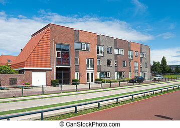 new townhouses - row of newly built modern townhouses in...