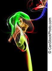 smoke of different colors on a black background