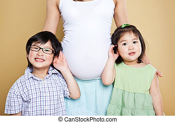 Pregnant Asian mother and her kids - A shot of a pregnant...