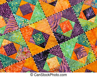Quilt Background - Section of a colorfully crafted quilt.