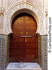 Ornate exterior wooden door of mosque - Fez, Morocco: Ornate...