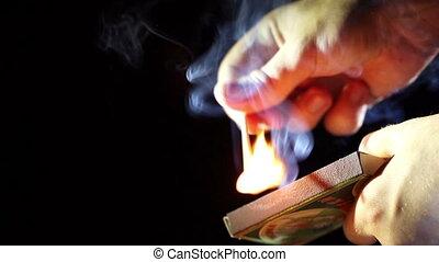 Burning match - Man burning match.