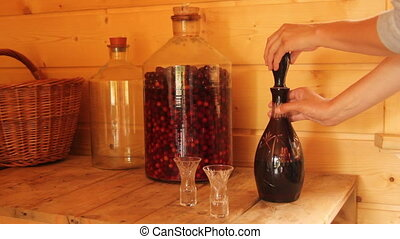 cherry brandy - pour cherry brandy from a decanter into the...