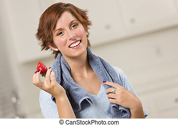 Pretty Red Haired Woman Holding Strawberry