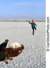 Girls Snowball Fight - A girls hands are ready to throw a...