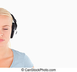 Close up of a charming woman with headphones