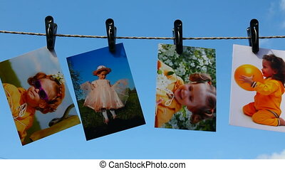 photos are hanging against blue sky
