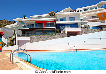 Swimming pool by luxury villas, Crete, Greece