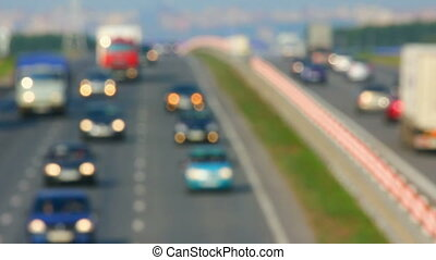 carstravelingon the highway - defocused