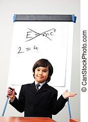 Genius little boy writting E=mc2 on the board, new formula...