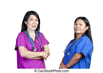 Two Female Asian Nurses in scrubs on white background