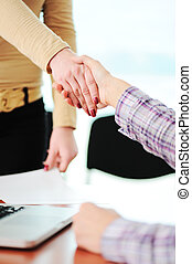 Closing a successful deal with a handshake Congratulations...
