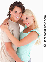 Portrait of a happy couple smiling in a studio