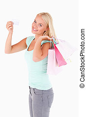 Portrait of a Smiling woman with a credit card and bags