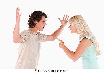 Unhappy couple arguing in a studio