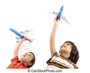 Two boys with airplains in hands