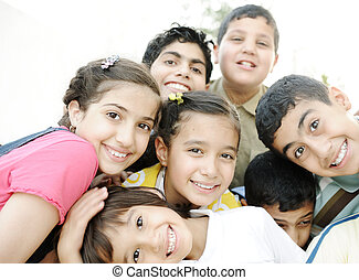 Horizontal  photo of children group,  friends smiling outdoor, boys and girls closeup