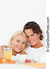 Portrait of a smiling couple having breakfast