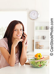 Woman telephoning at table