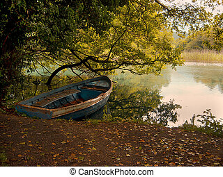 boat - autumn picture of lonely boat on the bank