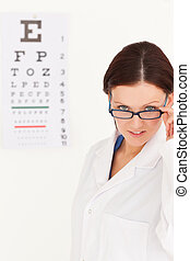 Female optician with glasses in office