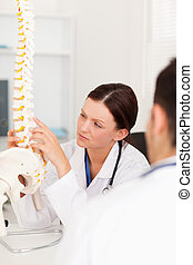 Female doctor touching a spine