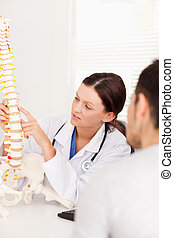 Doctor pointing on spine