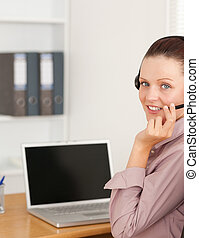 Operator with headset in office