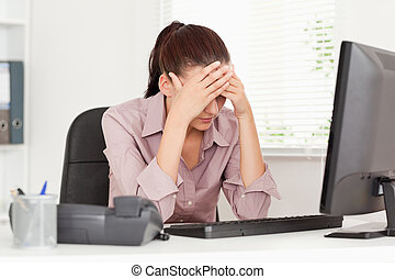 Depressed businesswoman - A depressed businesswoman in her...