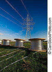 Construction of new power line - A power line tower in the...