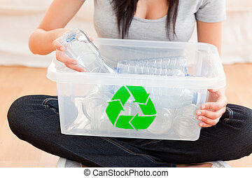 Woman with a recycling box